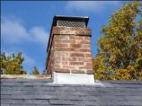 New chimney flashing was installed during re-roofing to protect one of several historic chimneys on the Thomas House.