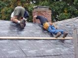 Roof underlayment is put on roof to insure a good weather-tight seal prior to installation of slates.