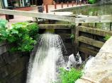 Water rushes through a canal lock in Georgetown in order to equalize the water levels
