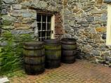 Old barrels stand outside the Old Stone House