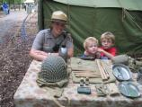 A Park Ranger and Jeffery and William Smith enjoy looking at World War II items.