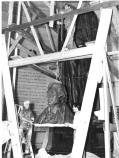 A temporary plaster statue was created and installed during WWII when bronze was not readily available. In April, 1947, the temporary statue is disassembled in the Jefferson Memorial prior to the permanent bronze statue being installed.