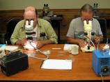 Members of the Maine Entomological Society use microscopes to make preliminary identifications of specimens.
