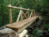 This new wooden bridge replaced an old, unsafe bridge in 2005.