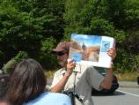 A volunteer shows visitors what a flying peregrine looks like.