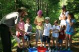 A ranger shows kids what they'll find in Duck Brook.