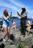 A ranger and a visitor use GPS units to navigate.