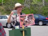 An Acadia National Park ranger gives a presentation about peregrine falcons as visitors view the falcons.