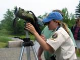 A volunteer prepares the scope that visitors will use to view peregrine falcons. The raptor volunteers usually spend from mid-May until mid-October at Acadia working with the Peregrine Watch and HawkWatch programs.