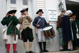 A fife and drum group entertain the crowd outside of The First Church in Weymouth before the wedding
