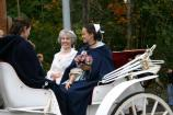 Abigail and her wedding party travel to the church in style by horse drawn carriage