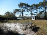 Pope Bay bayside backcountry campsite with picnic table, fire ring and Rom-Tec toilet