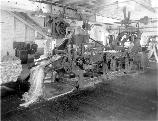 Once the bales of fiber were opened, they were fed into these breaker machines. brushes removed dirt, twigs and bark. The fibers were untangled and straightened before being sent to the drawing machines.