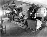 Another view of the breaker machine. Once the bales of fiber were opened, they were fed into these breaker machines. brushes removed dirt, twigs and bark. The fibers were untangled and straightened before being sent to the drawing machines.