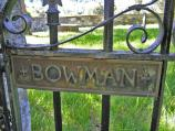 The front entrance gate to the cemetery, with the Bowman name clearly noted in a metal plaque on the gate.