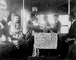 Edison employees learning to use tickets in new trolley car fare plan, 1919.