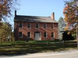 Mount Washington Tavern front view with fall foliage.