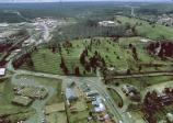 Aerial view of Marye's Heights. Fredericksburg Battlefield Visitor Center is in lower foreground. The terraced hillside and plateau of the Fredericksburg National Cemetery are in the center.