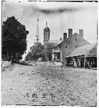 This 1864 photograph shows Princess Anne Street in Fredericksburg. The street was a Union staging area for the assaults on Marye's Heights in December 1862. The photo shows the steeple of St. George's Church, as well as the city courthouse.