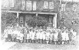 Children pose at Fort Hancock School in Bldg 102, c1930.