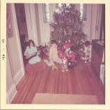 Col. Corley's children sit around Christmas tree in Quarters 9 at Fort Hancock, 1964.