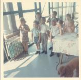 Col. Corley's son has a birthday party on the screened in front porch of Quarters 9, Fort Hancock in 1965.
