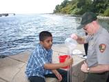 A student at I.S. 27 on Staten Island tests the turbidity of Hudson River water as part of the program