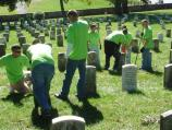 Volunteers from Dover Air Force Base straighten headstones in the Soldiers' National Cemetery.