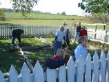Volunteers taking part in the park's Adopt A Position program replant the historic Leister House garden.