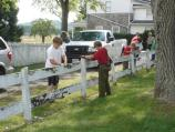 Members of Boy Scout Troop 122 prepare a fence for paint at the Reever Farm. The Scouts were taking part in the park's Adopt A aposition program.