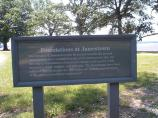 Sign explaining that the foundations seen in New Towne are reproductions.