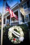 A wreath of white flowers honors John F. Kennedy at his birthplace, 83 Beals Street Brookline.