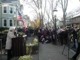 Visitors gather a John F. Kennedy's birthplace; a town leader addresses the crowd