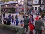 Costumed trick-or-treaters gather on the street in front of John F. Kennedy's birthplace.