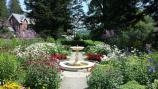 Marsh-Billings-Rockefeller NHP Formal Gardens & Mansion in full bloom in summer.