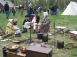 Visitors and re-enactors interact during the spring encampment.