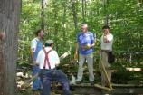 Trail Volunteers offer their knowledge of carpentry and engineering skills by helping rebuild a trail bridge.