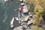 BASE jumper falling towards the river