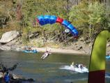 a BASE jumper is about to land in the river