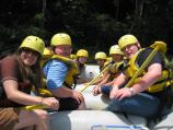 students pose in a raft