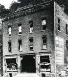 historic photo of three story building
