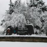 Canyon Rim Visitor Center sign in the snow
