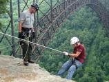 rock climber starts over the edge of the gorge