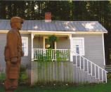 miner statue in front of coal camp house