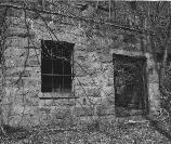 black and white photo of old coal camp building