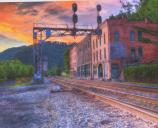 buildings and RR tracks with sunset