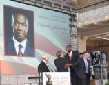 NBC Nightly News Managing Editor and Anchor Brian Williams congratulates NBA icon Dikembe Mutumbo on his award. Mutumbo received the B.C. Forbes Peopling of America Award for his contributions in the field of Sports.