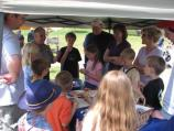 In addition to flag making activities, older children could learn how to roll cartridges for rifles, a common job for young Richmonders during the Civil War. Here Education Specialist Pat Ferrell demonstrates cartridge making before letting the kids try it.