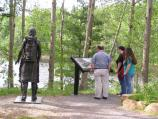 Each stop along the interpretive trail has a bronze statue and a wayside exhibit providing historical context.