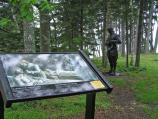 This wayside exhibit and bronze statue mark the fifth stop along the interpretive trail.